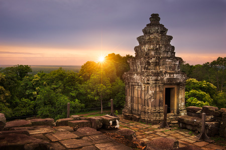 View of the sun setting over the Cambodian countryside from the summit of Phnom Bakheng.
