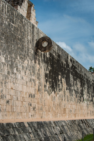 rubber ball: The goal at the Great Ballcourt at Chichen Itza. Players had to put a large rubber ball through the ring without the use of their hands. Stock Photo