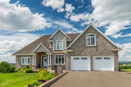 in the suburbs: A beautiful new house on a hill in Canada. Stock Photo