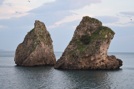 characteristic: sea scape features two high cliffs that aafiorano water very characteristic Stock Photo