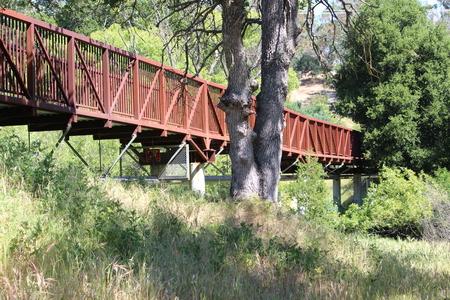 pedestrian bridges: Red Steel Bridge Stock Photo