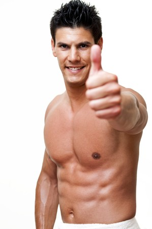 model photographed with towel, with thumbs up  photo