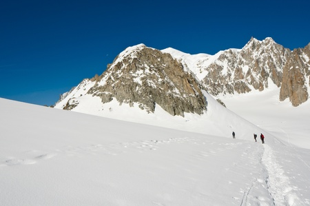 mountaineers on a Italian glacier (Mont Blanc Massif, Italian Alps) photo