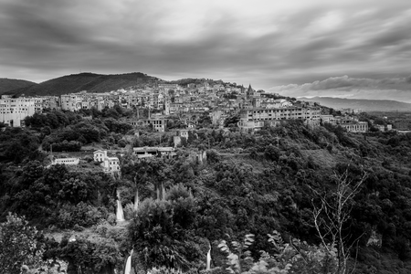 kilometres: Tivoli is an ancient Italian town in Lazio, about 30 kilometres (19 miles) east-north-east of Rome, at the falls of the Aniene river where it issues from the Sabine hills Stock Photo