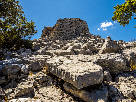 scrub grass: The nuraghe is the main type of ancient megalithic edifice found in Sardinia, developed during the Nuragic Age between 1900 and 730 BCE.Today it has come to be the symbol of Sardinia and its distinctive culture, the Nuragic civilization. Stock Photo