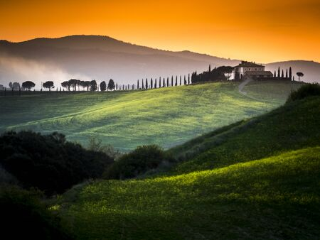 beautiful panorama of sunset in the Tuscany Hills. 版權商用圖片