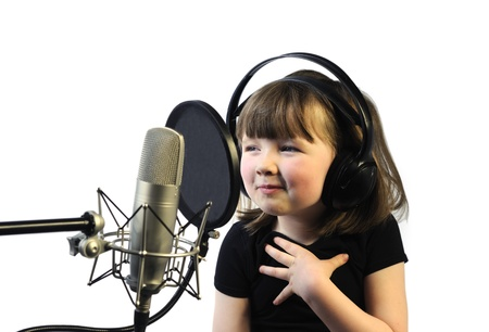 portrait young girl studio: little girl satisfied with her song recording