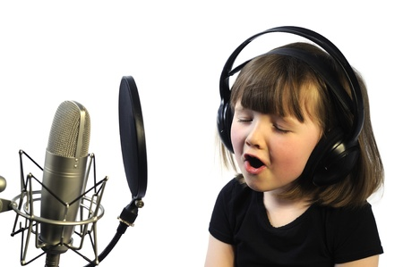 vocalist: little girl engrossed in recording a song Stock Photo