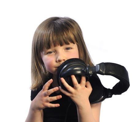 Little girl holding studio headphones photo