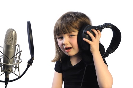 Little girl listening to the recording instructions photo