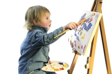 painter palette: Portrait of a child painting on canvas