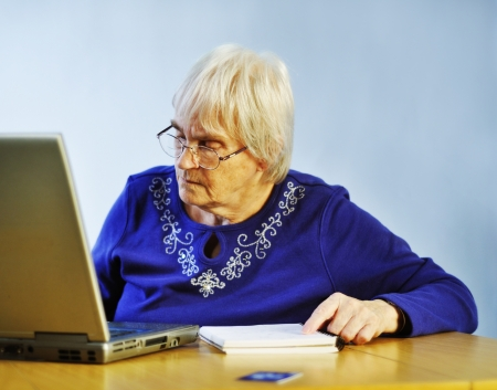 senior woman buying something on-line photo