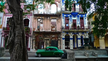 dring: Old green car passing in front of colonial buildings, Paseo del Prado street, Havana, Cuba