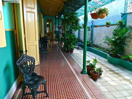 colonial house: Patio  corridor  pass way with plants and columns in a colonial house, Cienfuegos, Cuba