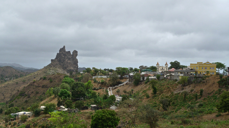 picos: Steep rock formation and Picos (Achada Igreja) village, Santiago Island, Cape Verde Stock Photo