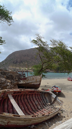 santiago cape verde: Old boats stranded on beach in Tarrafal, Santiago Island, Cape Verde Stock Photo