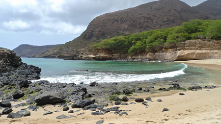 santiago cape verde: Black rocks on the beach of Tarrafal, Santiago Island, Cape Verde Stock Photo