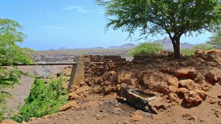 Fountain  spring  source and red rocks - Ribeira Grande, Santiago Island, Cape Verde Stock Photo