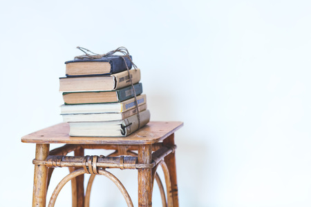 a long poem: books on a chair Stock Photo