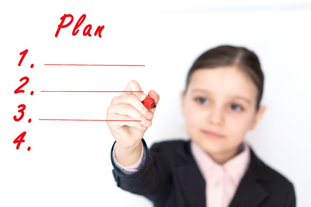 wrote: girl wrote a marker plan Stock Photo
