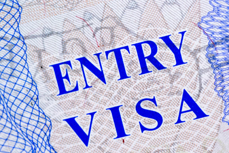 emigration: Visa stamp travel passport immigration macro emigration Stock Photo