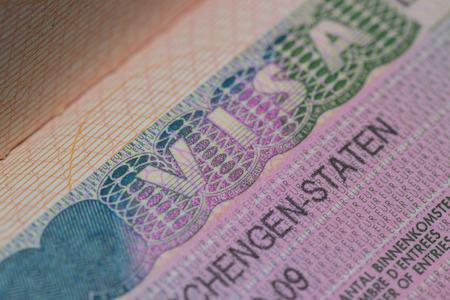 Visa stamp travel passport immigration macro emigration Stock Photo