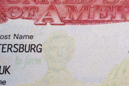 emigration immigration: Visa stamp travel passport immigration macro emigration Stock Photo