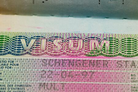 tilt views: Visa stamp travel passport immigration macro emigration Stock Photo
