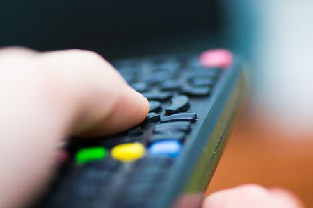 tv remote control television watching screen  device Stock Photo