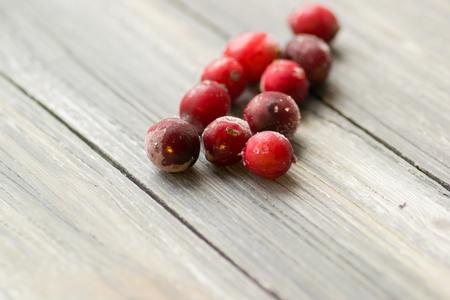 frozen berries closeup on wooden background vitamin Stock Photo