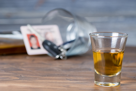 a stack of alcohol on wooden countertop with the keys