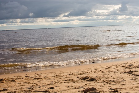 beach sea with the tide summer evening Stock Photo