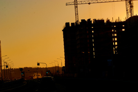 construction of the building cranes in the strongest light, otherwise from the sun Stock fotó
