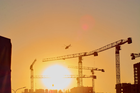 the plane flies high in the sky and the sun at sunset