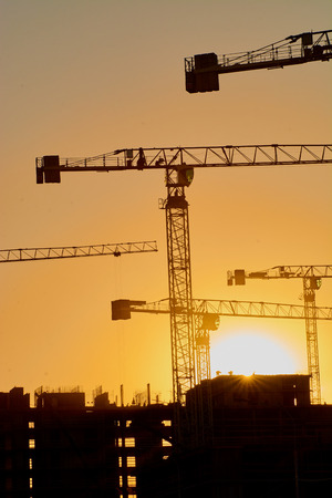 construction of the building cranes in the strongest light, otherwise from the sun