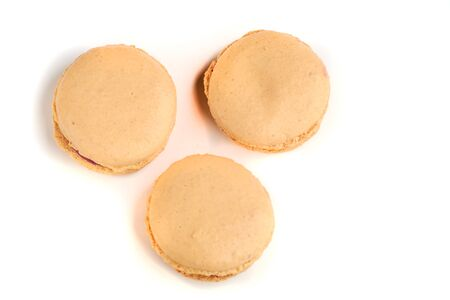 cooking homemade macarons at home with your hands on a white background
