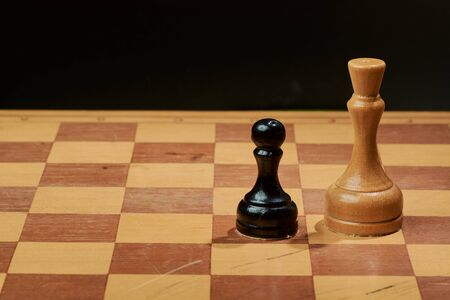 Black and White King and Knight of chess setup on dark background Stock Photo