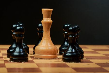 Black and White King and Knight of chess setup on dark background . Leader and teamwork concept for success. Chess concept save the king and save the strategy Stock Photo