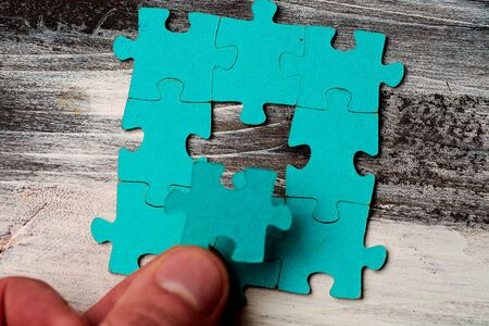 puzzle without details on a wooden background. Stok Fotoğraf