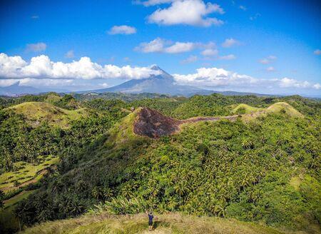 Quintiday hills and Mayon volcano Stock Photo