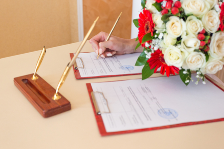 the Bride puts the Signature in the Palace of Marriage Stock Photo