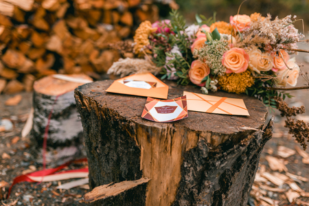 field maple: wedding autumn flower composition with roses and other decor close up.