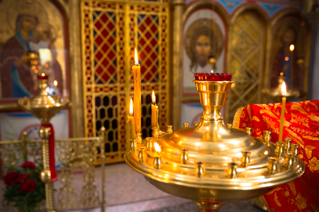 Holy Bible and Orthodox cross prepared for christening ceremony in russian church. Stock Photo