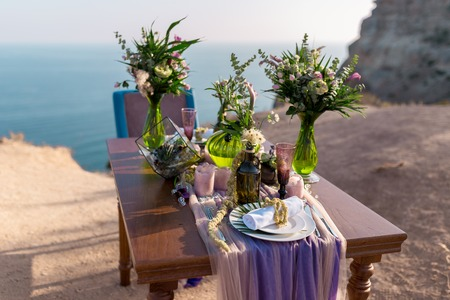romantic dinner setup ,on the beach with sunset.