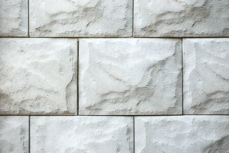 Grey brick wall texture background. Tiled