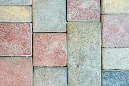 Pavimentazione in pietra texture. Sfondo di pavimentazione in ciottoli di granito. Sfondo astratto del vecchio primo piano pavimentazione in ciottoli. Archivio Fotografico