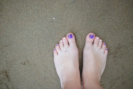 Selfie of feet on beach sand background, top view Stock Photo