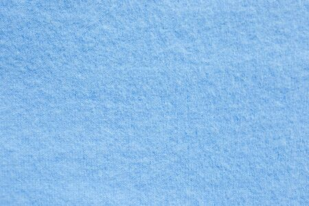 Background texture of blue pattern knitted fabric made of cotton or wool. close up