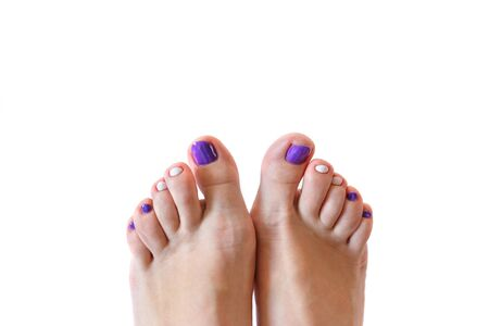Closeup photo of a beautiful female feet with pedicure isolated on white. Banco de Imagens