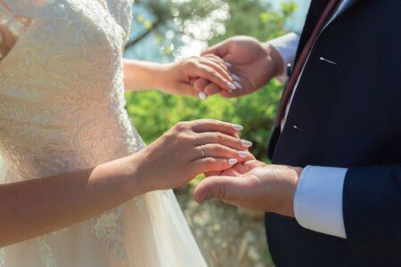 Wedding couple holding hands. Bridge and groom